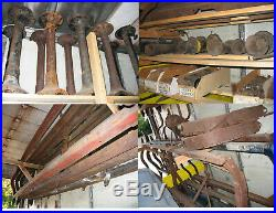 Model T and TT parts around 24,000 pounds of them & box trailer with shelves
