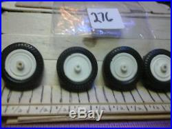 Model car parts 4 chrome rims with tires. 1 / 25 scale